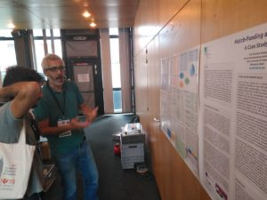 Ricard Espelt presenting his poster at the conference